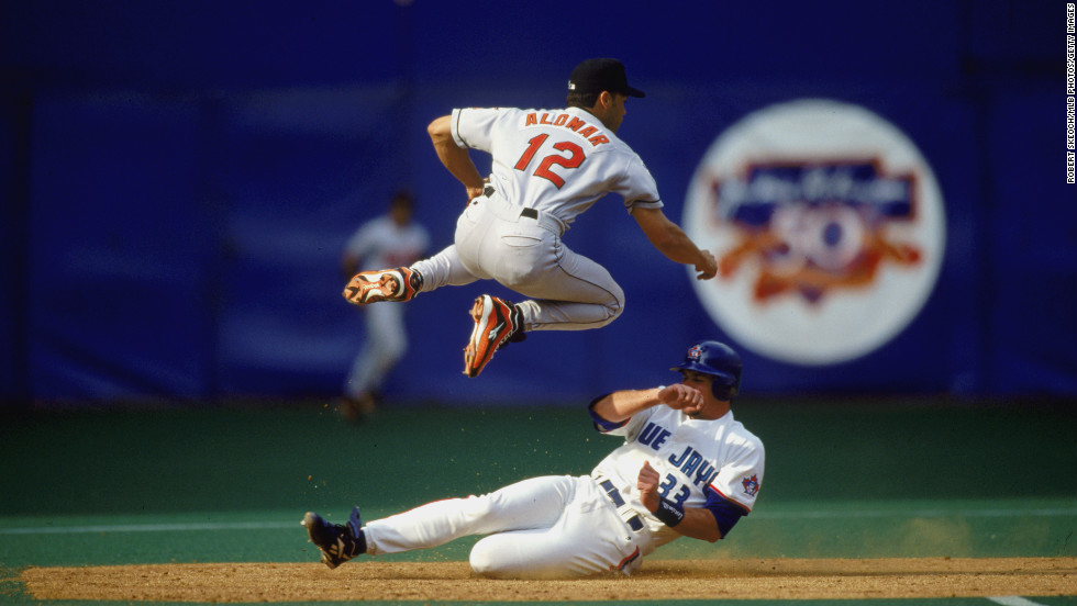 """Dubbed """"Remember the Alomar"""" by ESPN's Chris Berman, Roberto Alomar, a Puerto Rico native, is one of the best second basemen in history. His tight defense earned him 10 Gold Gloves, but he could also put wood on the horsehide as he racked up four Silver Sluggers, given for the best offensive player at each position. A journeyman who played for seven teams, Alomar appeared in every All-Star game from 1990 to 2001. He retired in 2005 with a tidy .300 batting average."""