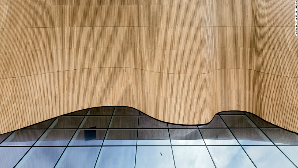 "The elegant curve of the Kilden Theatre ceiling is a real showpiece of craftsmanship in wood, made out of local oak planks. All images © <a href=""http://www.uusheimo.com"" target=""_blank"">Tuomas Uusheimo</a>"