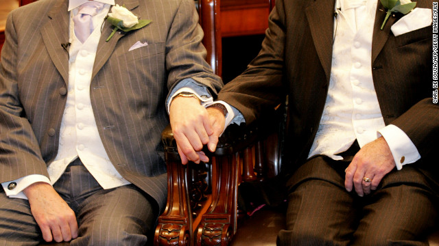 (File photo) A couple holds hands in Brighton before becoming one of the first same sex couples to form legal civil partnerships in England.