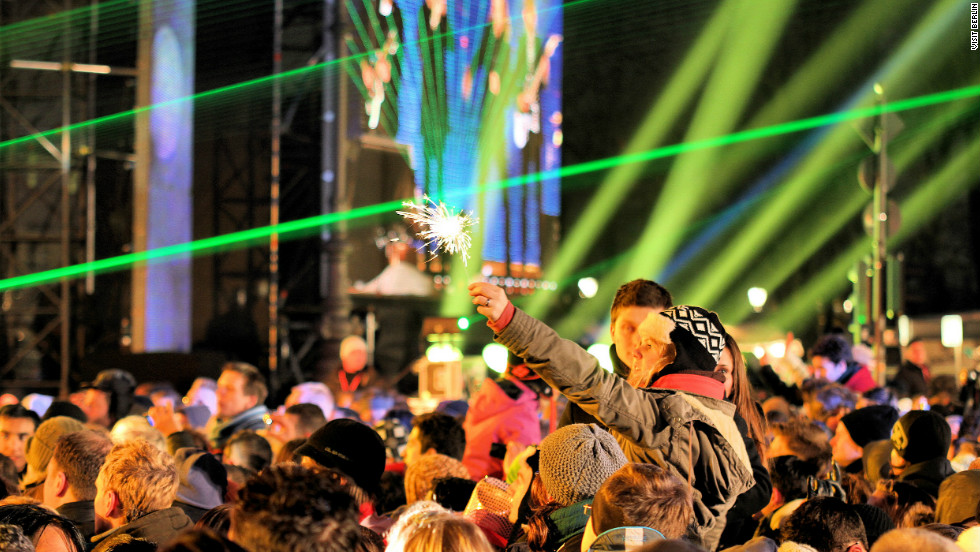 "Berlin is renowned for hosting one of the world's largest open-air New Year celebrations. DJ's entertain music fans along the ""Party Mile"": a two kilometer strip of dancefloors, stages and bars behind the Brandenburg Gate."