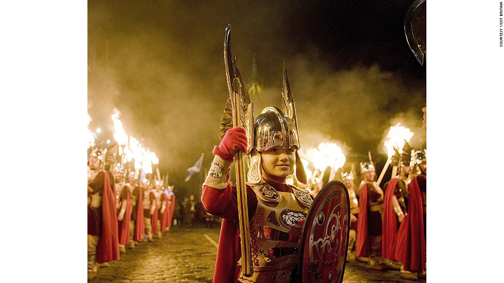 Edinburgh's annual New Year's Eve (Hogmanay) festivities are cast aglow with a torchlight procession involving more than 25,000 locals. The parade is led by Shetland's Up Helly Aa vikings (pictured).