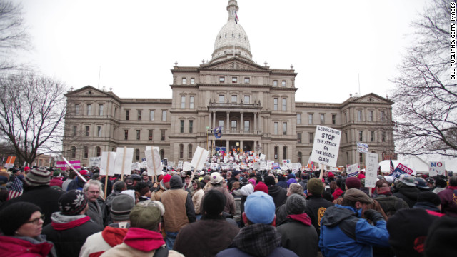 Sweeping law limits union power in MI