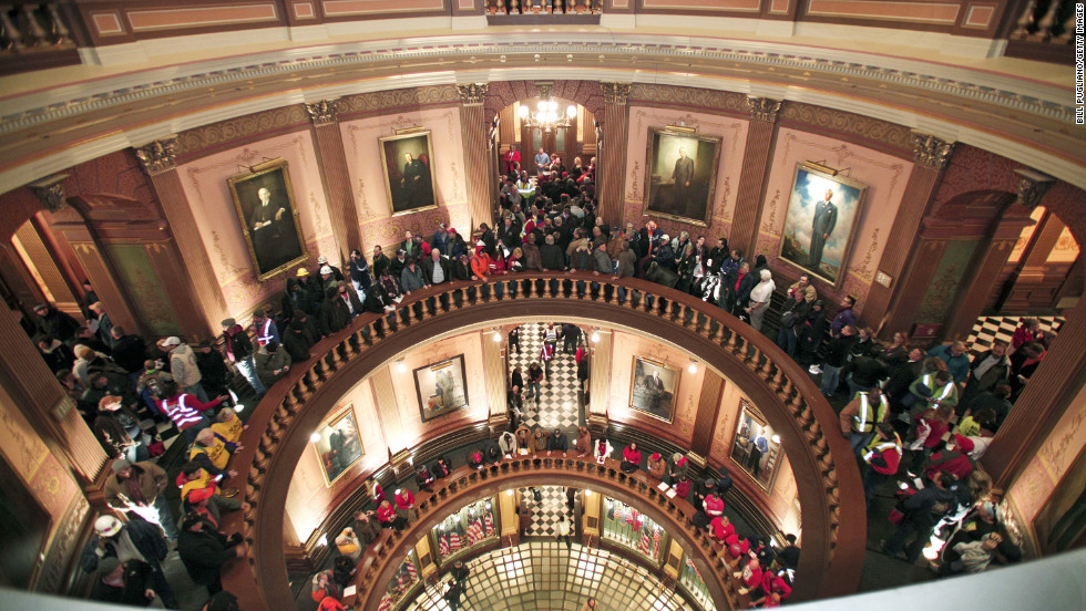 People line up to try to enter the House chamber in the Michigan State Capitol where the bills are voted on.