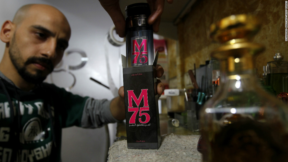 An employee of the 'Stay Stylish' shop in Gaza City displays a bottle of M75 perfume -- named after the long-range rocket used by Hamas in the recent conflict with Israel.