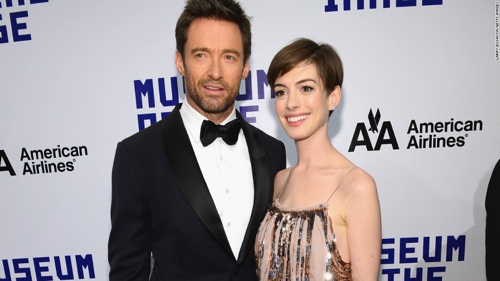 """Les Miserables"" co-stars Hugh Jackman and Anne Hathaway pause on the red carpet as they arrive at the Museum of Moving Images Salute to Hugh Jackman in New York City on December 11."