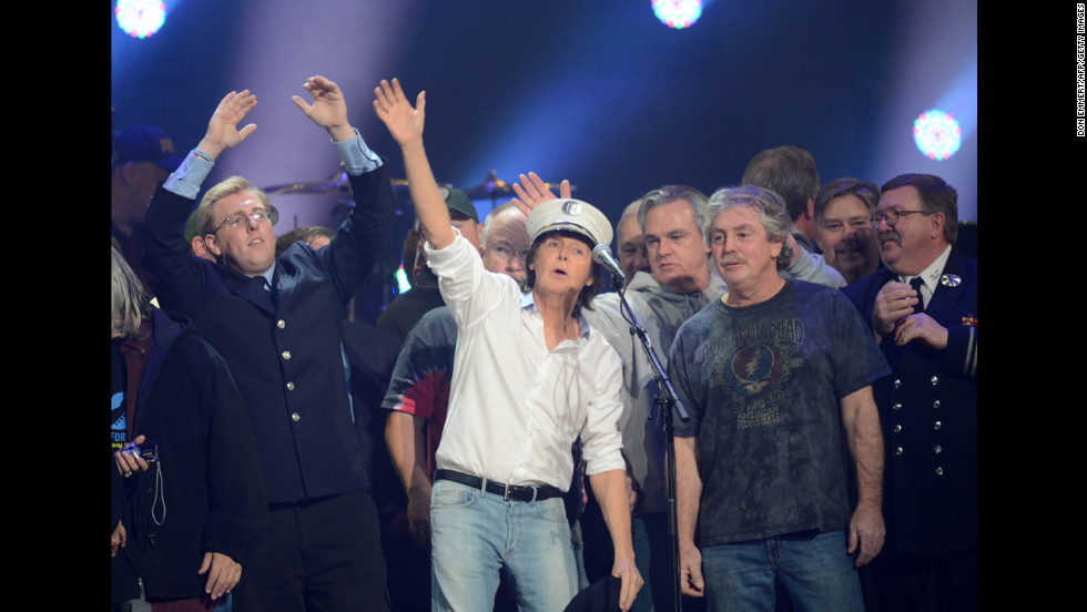 Sir Paul McCartney performs on stage with a crowd during the concert finale. Proceeds from 12-12-12 benefit the Robin Hood Relief Fund, which is assisting storm victims in New York, New Jersey and Connecticut.