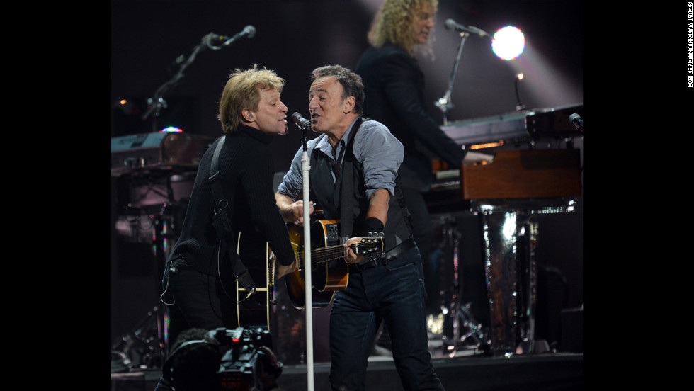 "Jon Bon Jovi, left, and Bruce Springsteen share the mic to raise money for victims of Hurricane Sandy. ""This recovery is not going to be quick,"" Bon Jovi told the crowd during his set. ""We need your support."""