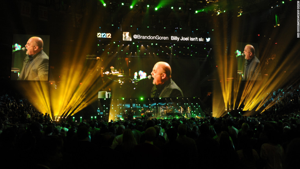 Jumbo screens project multiple images of Billy Joel's performance on Wednesday.