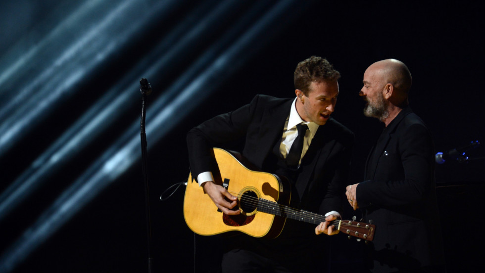 Chris Martin, left, of Coldplay and Michael Stipe of R.E.M. confer during their performance.