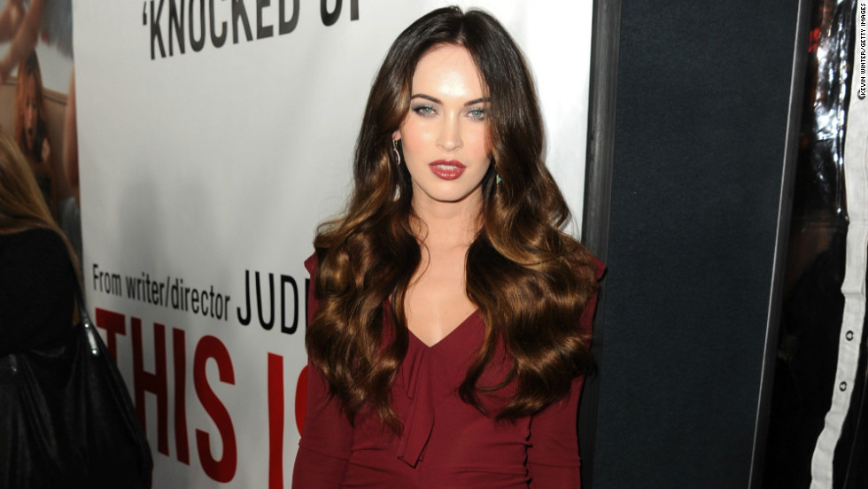 "Megan Fox pauses to show off her dress as she arrives at the premiere of ""This is 40"" on December 12."