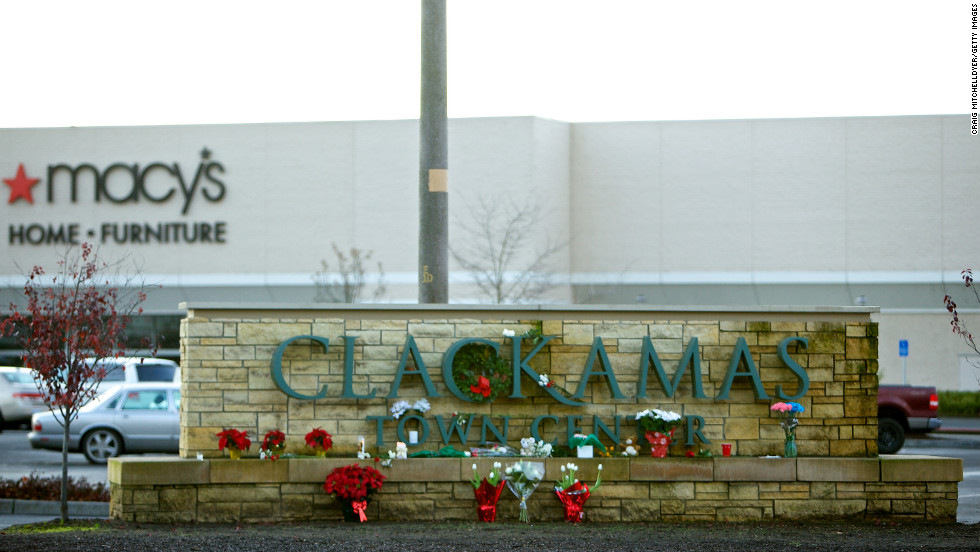 A makeshift memorial graces the Clackamas mall sign on December 13.