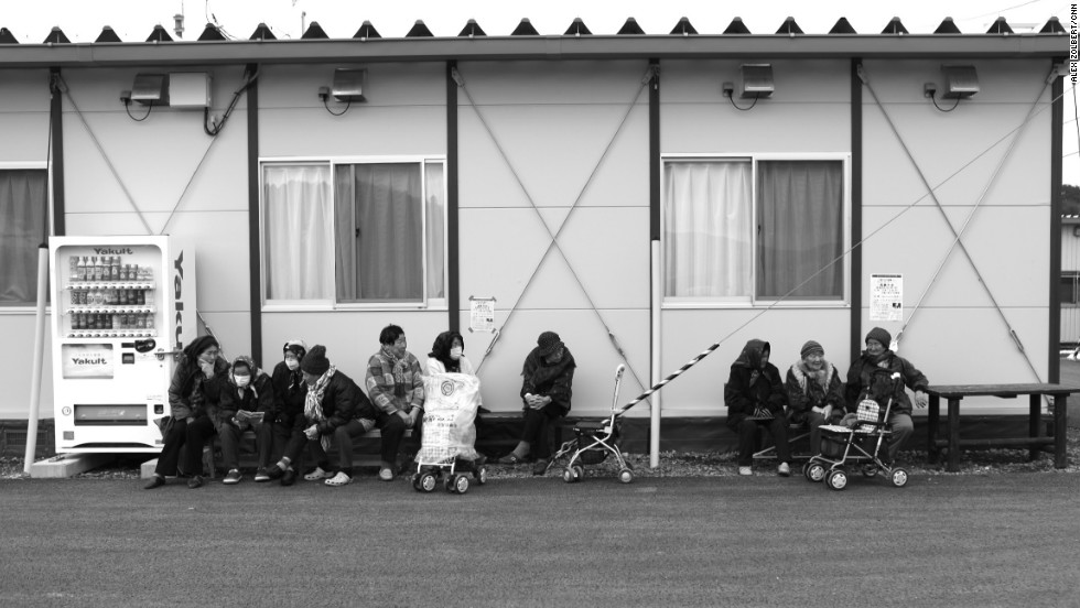 Elderly residents huddle against the cold on benches outside their temporary housing estate in Ishinomaki, the Tohoku region of Japan, in March 2012. They're among hundreds of thousands of people waiting for the government to build them new homes more than one year after the earthquake and tsunami.