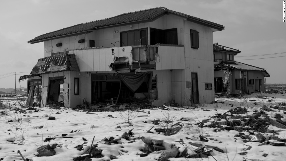 A damaged house in Ishinomaki remains abandoned, one year after the tsunami. Some survivors don't think the election of a new prime minister will speed up reconstruction plans. Others fear it will cause more delays.