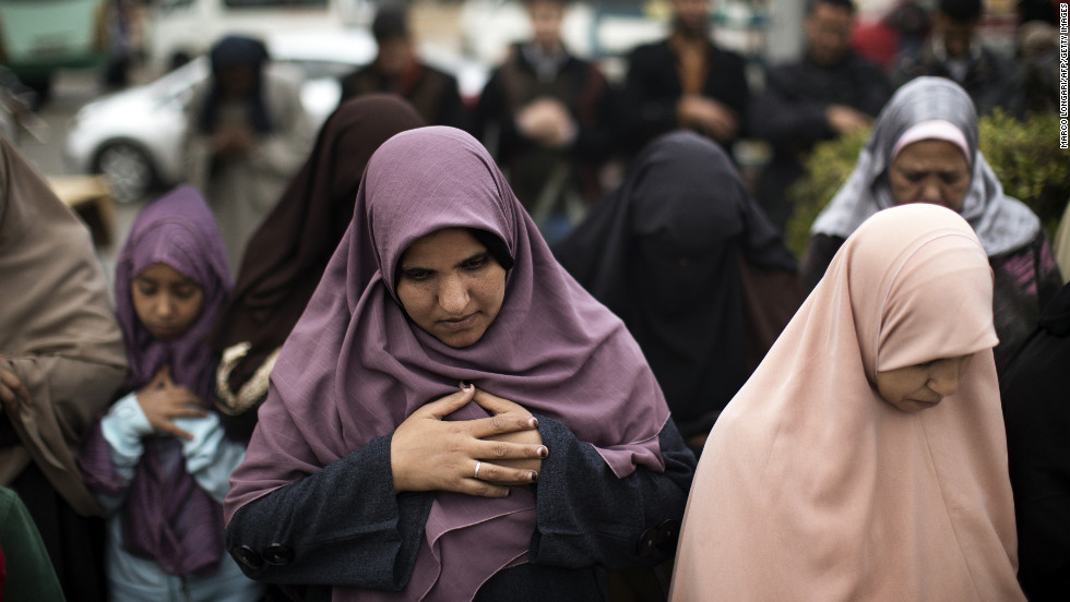 Women pray during a demonstration in support of President Mohamed Morsy in Cairo on December 14.