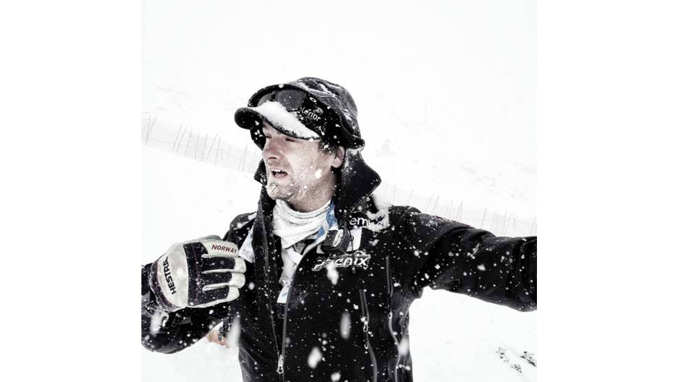 Norwegian ski coach Haavard Lie battles the elements during national team training in Solden.