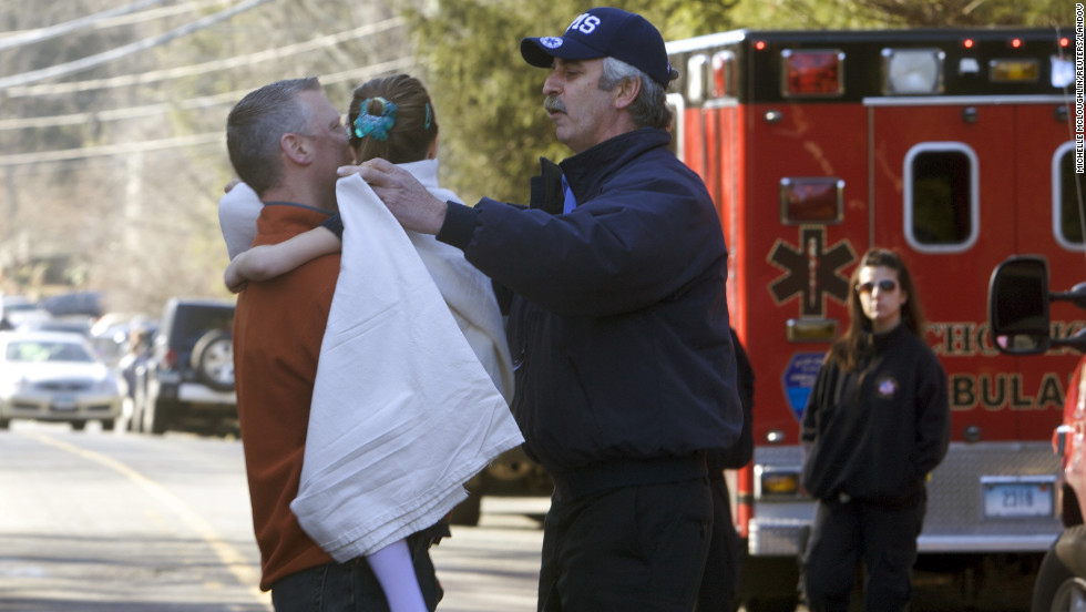 A young girl is given a blanket after being evacuated from Sandy Hook Elementary School on December 14.