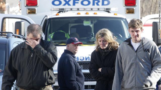 Relatives react outside Sandy Hook Elementary School on December 14.