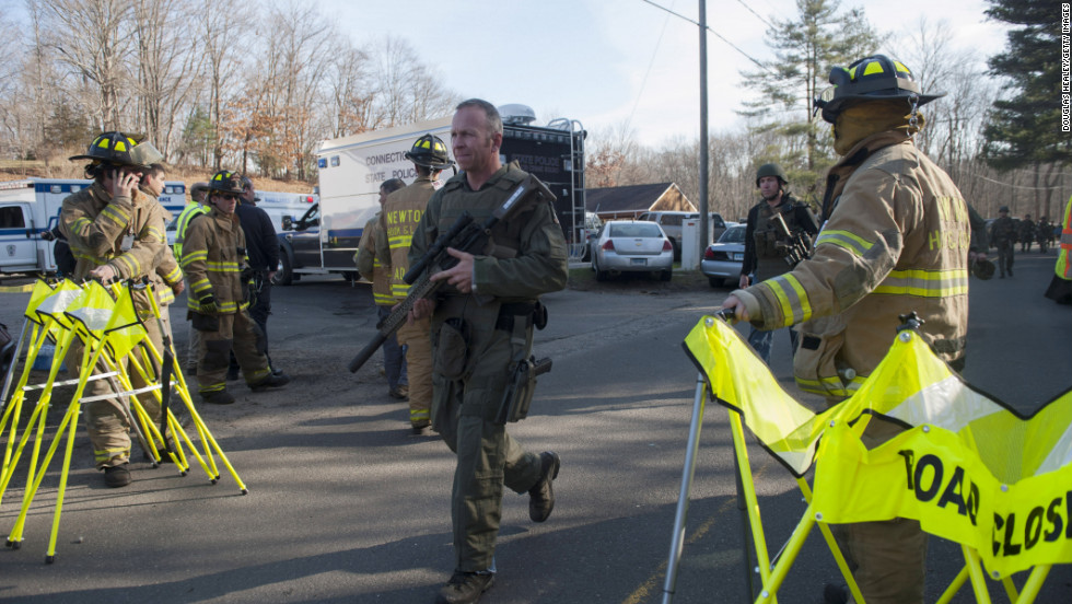 Connecticut State Police secure the scene of the shooting on December 14.