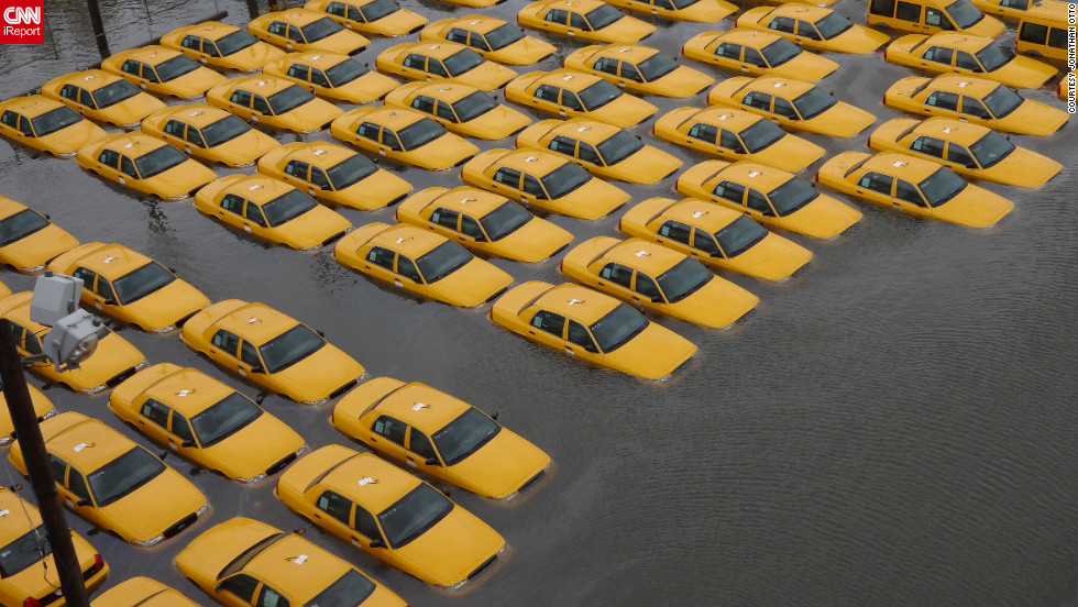"A fleet of taxi cabs sat submerged in a flooded parking lot in <a href=""http://ireport.cnn.com/docs/DOC-868854"">Hoboken, New Jersey</a>, after Superstorm Sandy hit the area in October. Photographer Jonathan Otto said, ""The picture was taken from the 14th street viaduct looking over the corner of Jefferson and 14th street, where it appears New York stores new cabs."""