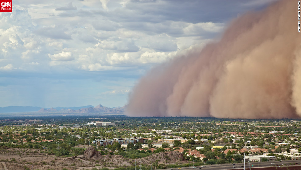 "A massive haboob, or dust storm, overtook <a href=""http://ireport.cnn.com/docs/DOC-818051"">Phoenix, Arizona</a> in July, and Andrew Pielage knew he had to get it on camera. Racing up a mountain that was nearby, he skipped the official trail to get a better view and was able to capture it from a very unique angle. ""I had made it just in time. You really get a good and scary sense of the size and magnitude of these types of storms. It will be a photograph I will never forget."""