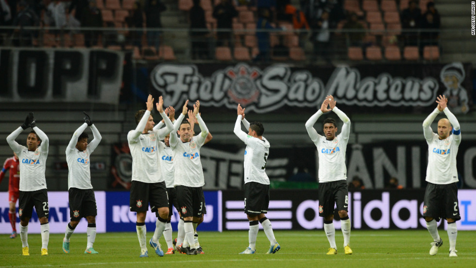 After the 1-0 semifinal win over Ah-Ahly, the Corinthians players applaud their travelling fans in the Toyota stadium