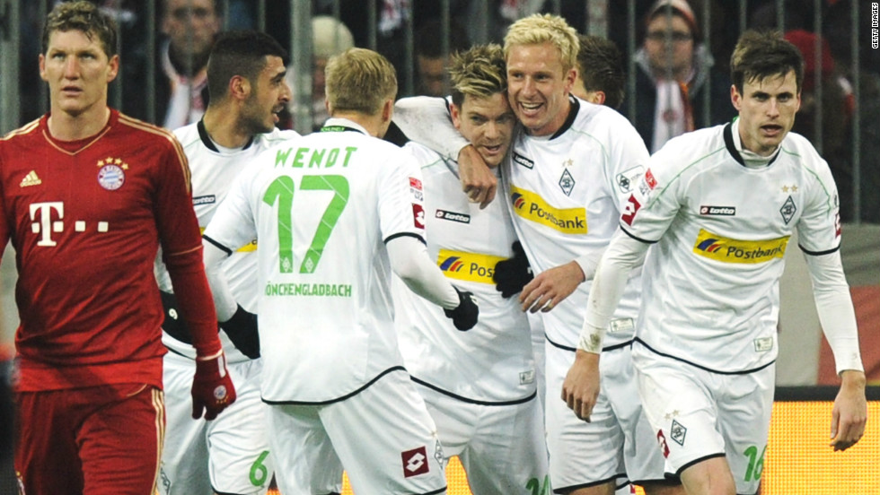 Thorben Marx celebrates his teammates after giving the visitors a 21st-minute lead, dampening the Bayern fans' prematch party mood.