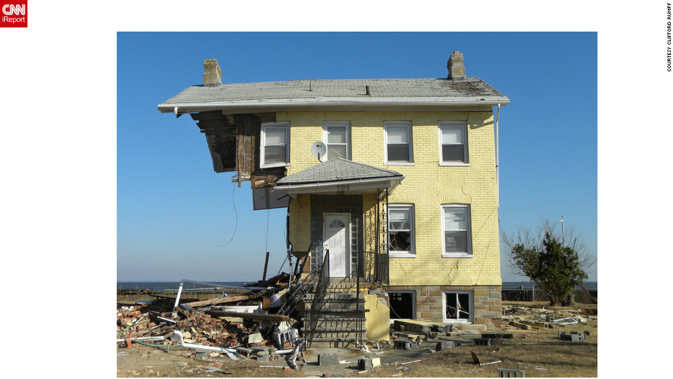 "A house in <a href=""http://ireport.cnn.com/docs/DOC-883706"">Union Beach, New Jersey</a>, was left standing despite being ripped apart from the winds of Superstorm Sandy in October. While photographing the area, Clifford Rumpf said each photo taken of the ravaged neighborhood was more shocking than the next. See more Sandy images <a href=""http://ireport.cnn.com/open-story.jspa?openStoryID=865705"">here</a>."