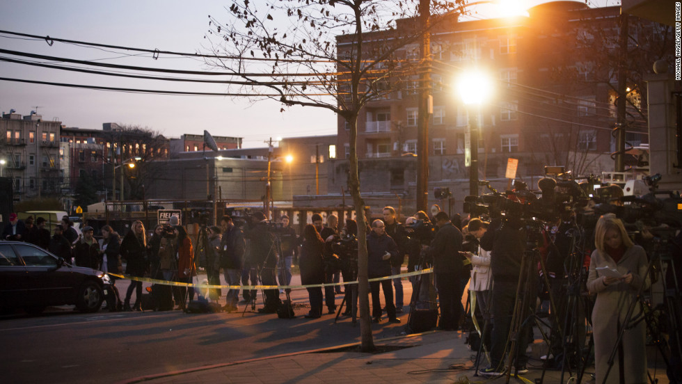 Members of the media converge on December 14 in front of an apartment at 1313 Grand Street in Hoboken, New Jersey. The apartment is believed to be connected to the Connecticut elementary school shooting.