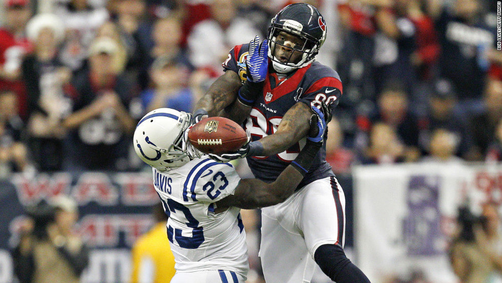 Andre Johnson of the Houston Texans goes up over Vontae Davis of the Indianapolis Colts for a reception in the first half on Sunday in Houston.