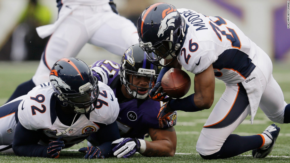 Free safety Rahim Moore of the Broncos recovers a fumble in front of running back Ray Rice of the Ravens and teammate Elvis Dumervil during the first half on Sunday.