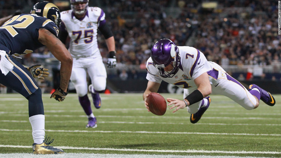 Christian Ponder of the Minnesota Vikings scores a touchdown against the St. Louis Rams at the Edward Jones Dome on Sunday in St. Louis, Missouri.