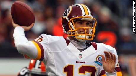 Quarterback Kirk Cousins of the Washington Redskins throws a pass as he is pressured by defensive lineman Juqua Parker of the Cleveland Browns at Cleveland Browns Stadium on Sunday, December 16, in Cleveland, Ohio.