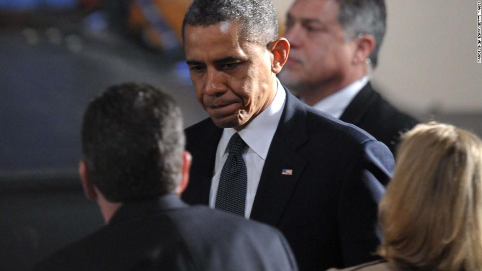 President Obama enters the auditorium, signaling the start of the vigil.