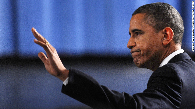 U.S. President Barack Obama waves as he arrives at the memorial service.
