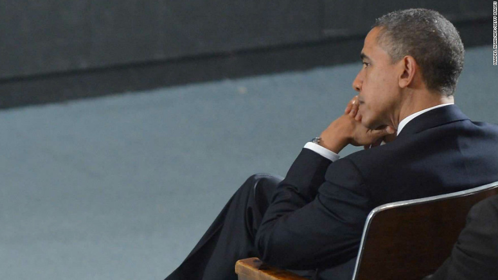 President Barack Obama listens to speakers at the vigil. Periods of reflective silence were scheduled into the program.
