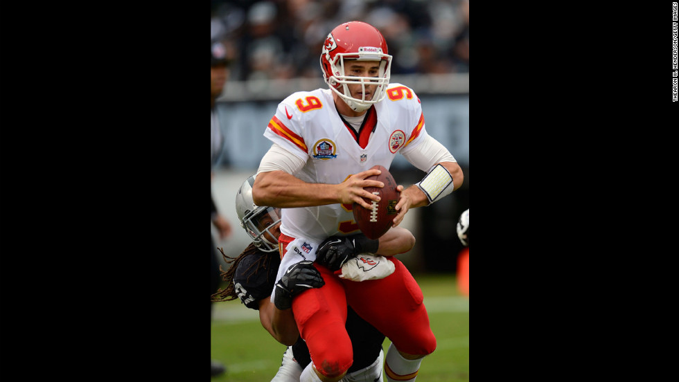 Brady Quinn of the Chiefs gets sacked by Philip Wheeler of the Raiders in the first quarter on Sunday.