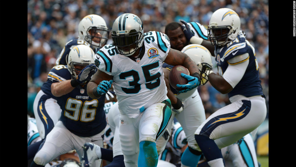 Mike Tolbert of the Panthers runs the ball against the Chargers on Sunday.