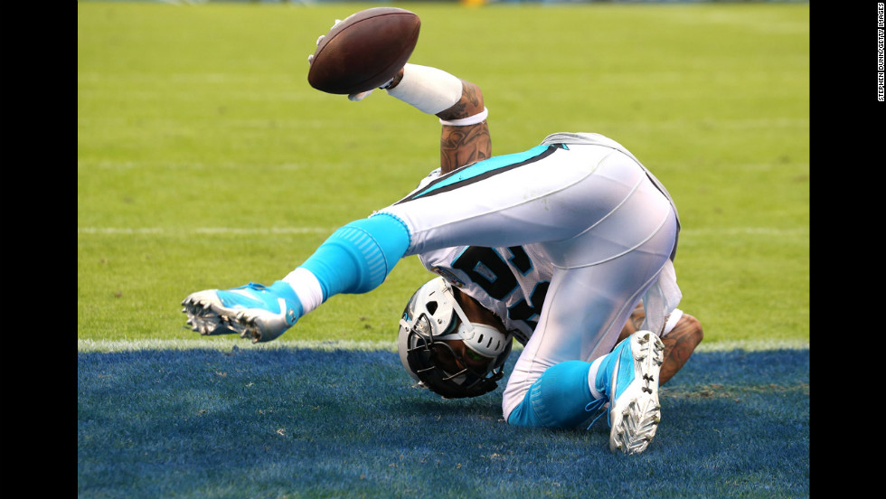 Wide receiver Steve Smith of the Panthers holds up the ball as he rolls after making a diving catch in the end zone on a 4-yard touchdown play in the third quarter against the Chargers on Sunday.