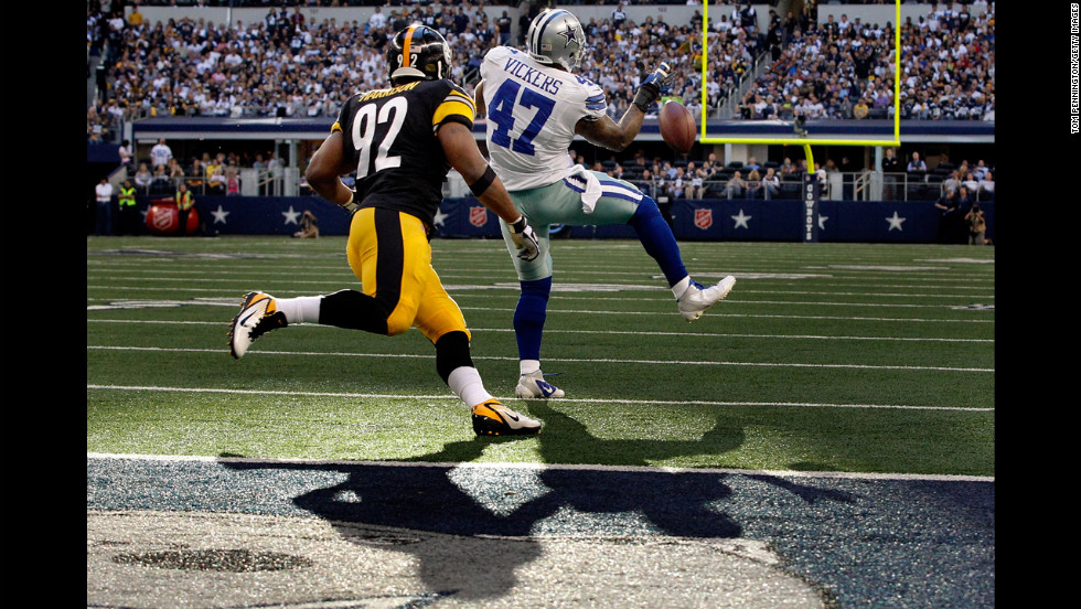 Lawrence Vickers of the Dallas Cowboys bobbles a pass incomplete against James Harrison of the Pittsburgh Steelers at Cowboys Stadium on Sunday, December 16, in Arlington, Texas.