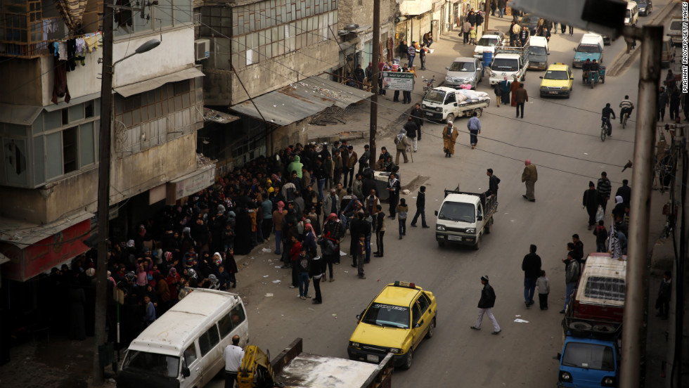 Syrians line up outside a bakery offering cheap bread in Aleppo, Syria on Sunday, December 16.