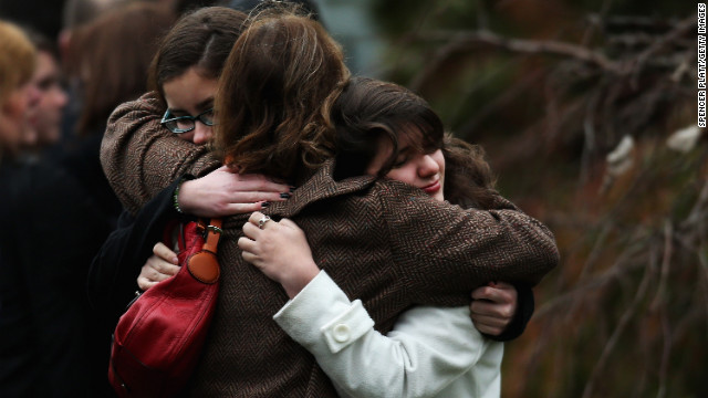 FAIRFIELD, CT - DECEMBER 17:  Three women embrace as they arrive for the funeral services of six year-old Noah Pozner, who was  killed in the shooting massacre in Newtown, CT, at Abraham L. Green and Son Funeral Home on December 17, 2012 in Fairfield, Connecticut. Today is the first day of funerals for some of the twenty children and seven adults who were killed by 20-year-old Adam Lanza on December 14, 2012.  (Photo by Spencer Platt/Getty Images)