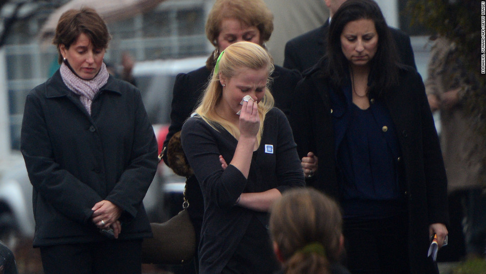 Mourners grieve the death of Jack Pinto, 6, on December 17.