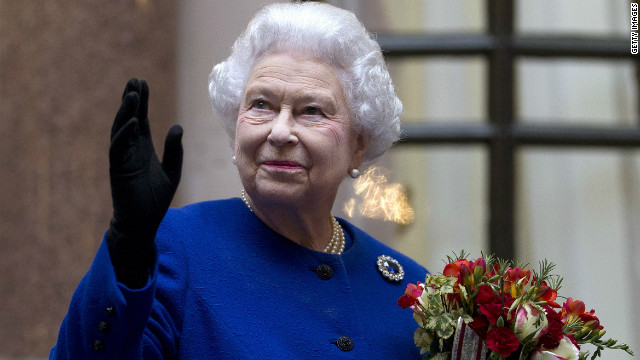 Queen Elizabeth II looks up and waves to members of staff of The Foreign and Commonwealth Office as she ends an official visit which is part of her Jubilee celebrations on December 18, 2012 in London.