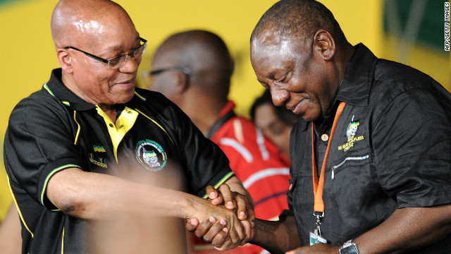 Jacob Zuma (L) congratulates Cyril Ramaphosa for being elected ANC deputy president on December 18, 2012 in Bloemfontein.