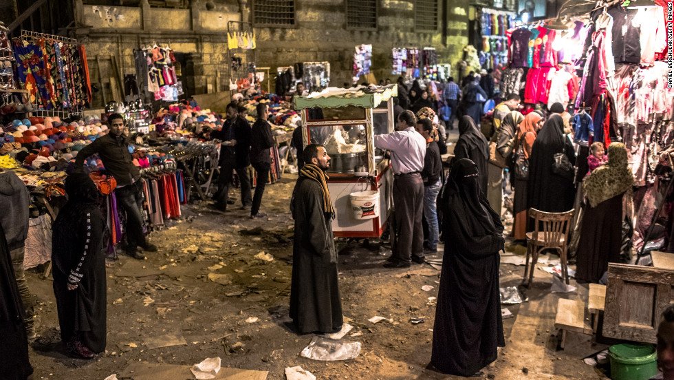 People make their way through a market place on Monday, December 17, in Cairo.