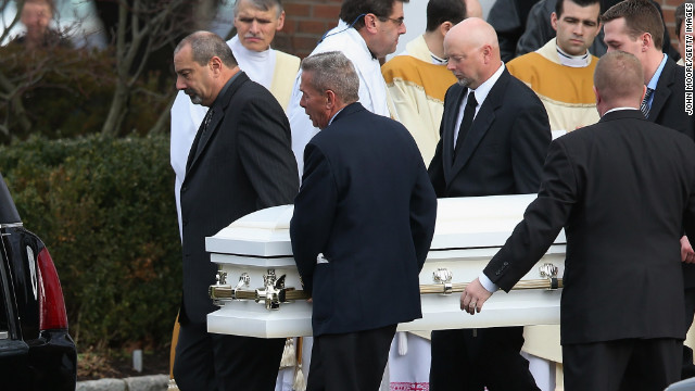 A casket carrying the body of shooting victim Jessica Rekos, 6, is brought out after her funeral at the St. Rose of Lima Catholic church on Tuesday, December 18.