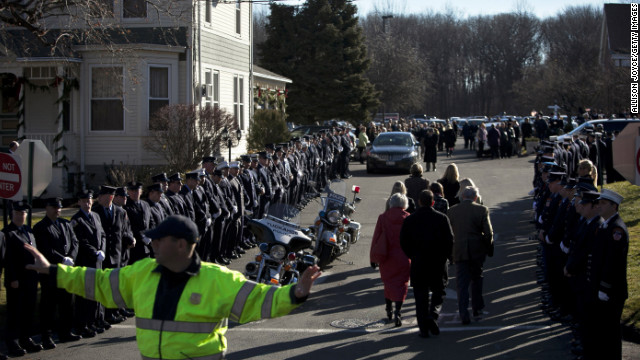 A policeman diress traffic as mourners enter the church for Charlotte Bacon's funeral on December 19.