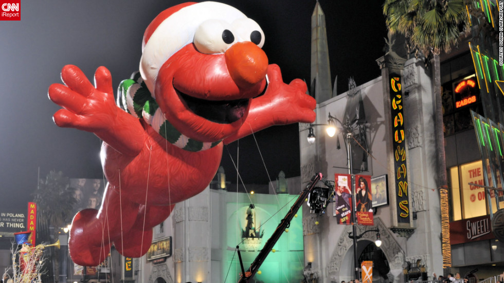 "<a href="" http://ireport.cnn.com/people/donnaclare"">Donna Clare</a> captured this fun shot of a giant inflatable Elmo -- of the popular children's TV show, Sesame Street -- floating high above the Hollywood Christmas Parade. ""The event, as expected was a Hollywood affair, complete with lots of red carpet and lots of celebrities,"" she said. ""[It] felt like a movie premiere more so than a parade."""
