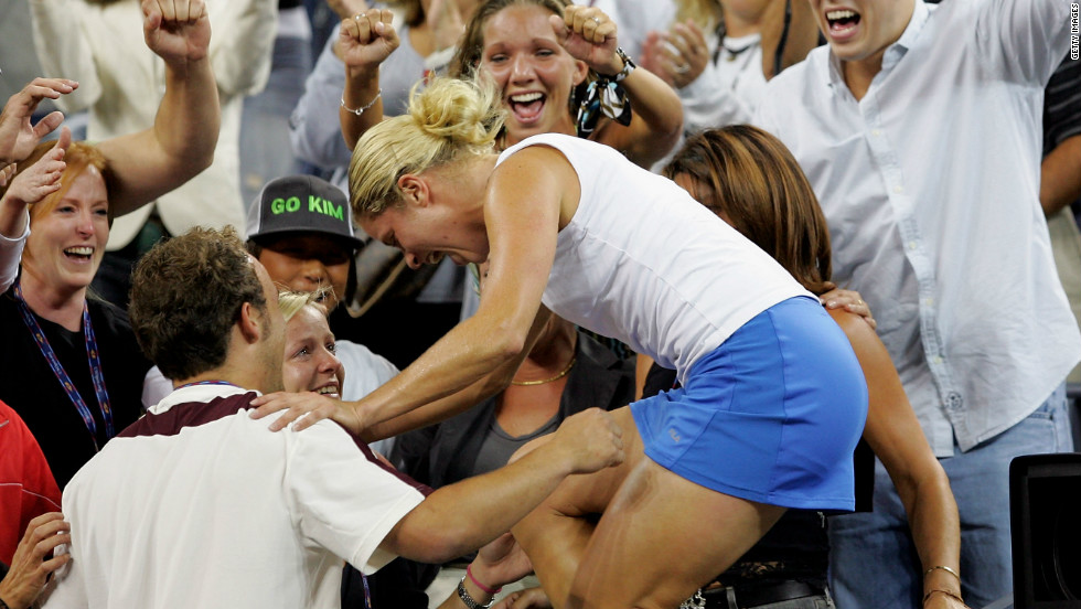 Clijsters had a love affair with New York. Here she climbs into the family area after the 2005 U.S. Open final after beating France's Mary Pierce 6-3 6-1 to clinch her first grand slam title.