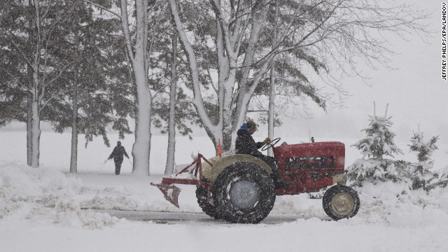A man uses a tractor to clear snow in Waupun, Wisconsin, on Thursday, December 20. Governor Scott Walker has declared a state of emergency in Wisconsin, mobilizing the Wisconsin National Guard as some areas are expecting up to 16 inches of snow and blizzard conditions.